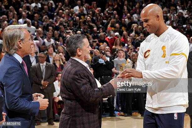 Owner Dan Gilbert presents Richard Jefferson of the Cleveland Cavaliers with his championship ring before the game against the New York Knicks on...