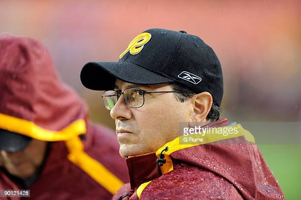 Owner Daniel Snyder of the Washington Redskins watches warm-ups before the game against the Pittsburgh Steelers at Fed Ex Field on August 22, 2009 in...