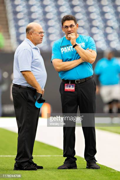 Owner David Tepper and Head Coach Ron Rivera of the Carolina Panthers talk on the field before a game against the Houston Texans at NRG Stadium on...