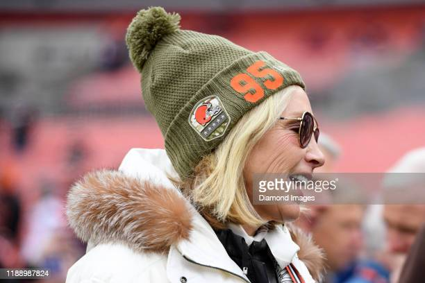 Owner Dee Haslam of the Cleveland Browns wears a hat with a number 95 in support of defensive end Myles Garrett on the sideline prior to a game...