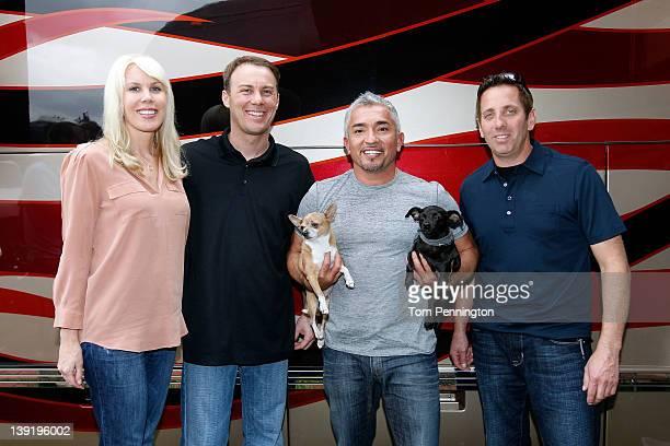 Owner DeLana Harvick driver/owner Kevin Harvick Cesar Millan dog behavior specialist and driver Greg Biffle pose in the Driver/Owner Lot at Daytona...