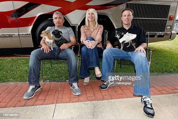 Owner DeLana Harvick , driver/owner Kevin Harvick , Cesar Millan , dog behavior specialist, pose in the Driver/Owner Lot at Daytona International...