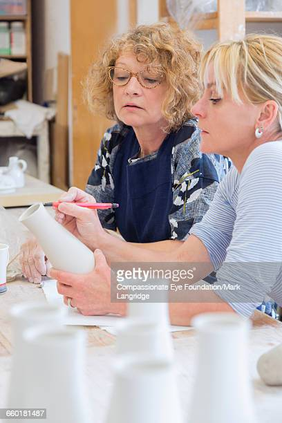 """owner discussing pot with coworker - """"compassionate eye"""" stock pictures, royalty-free photos & images"""