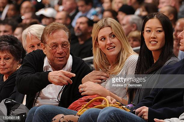 Owner Donald Sterling of the Los Angeles Clippers sits with LPGA player Michelle Wie during a game against the Phoenix Suns at Staples Center on...