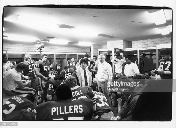 Owner Edward De Bartolo Jr and head coach Bill Walsh of the San Francisco 49ers talks to the players in the locker room during the1983 NFC...