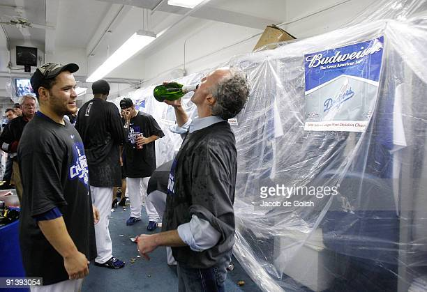 Owner Frank McCourt and Russell Martin celebrate in the locker room after winning the National League West against the Colorado Rockies on October 3...