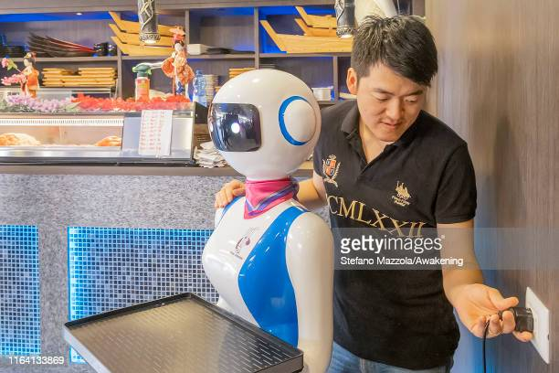 Owner Gabriele Hu charges a robot waiter on July 25 2019 in Rapallo Italy The Gran Caffè Rapallo restaurant in Liguria is the first restaurant in...