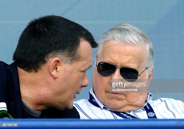 Owner George Steinbrenner of the New York Yankees talks with his son Hank against the Philadelphia Phillies at George Steinbrenner Field April 1 2009...