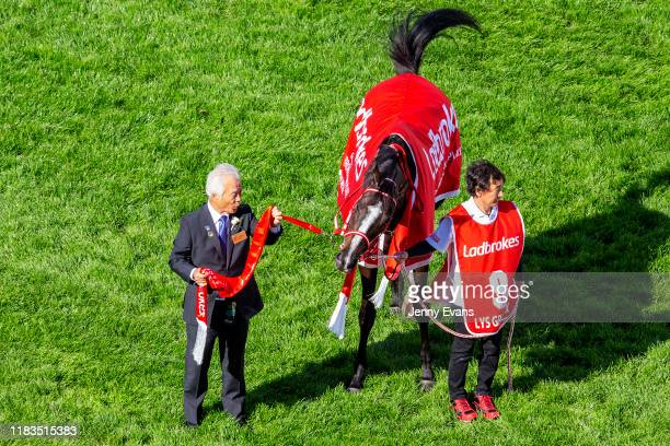 Owner Hiroaki Akita holds Lys Gracieux after winning race 9 the Ladbrokes Cox Plate during Cox Plate Day at Moonee Valley Racecourse on October 26,...