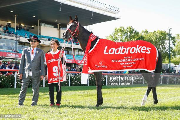 Owner Hiroaki Akita poses for a photo with Lys Gracieux after winning race 9 the Ladbrokes Cox Plate during Cox Plate Day at Mooney Valley Racecourse...