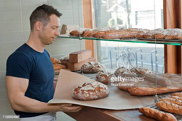 Owner holds rustic bread