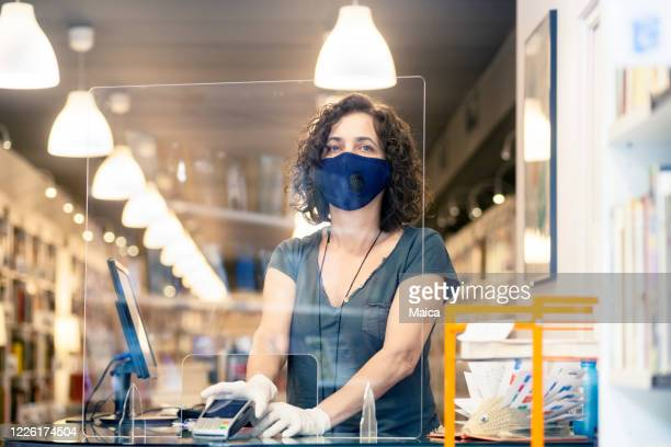 owner in the bookstore during covid - safety stock pictures, royalty-free photos & images