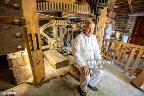Owner James Tallon poses by the cogs and inner workings of Martry Mill in Kells County Meath Ireland on April 27 2020 Records of a mill on the...