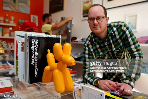 Owner Jamie Alexander of Park Life store and gallery next to the balloon dog bookend at his store in San Francisco, Calif., on Tuesday, January 25,...