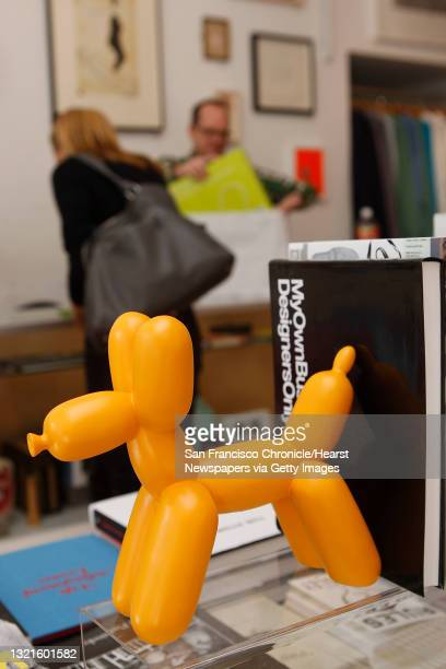 Owner Jamie Alexander selling a balloon dog bookend to art advisor Lizanne Suter at Park Life store and gallery in San Francisco, Calif., on Tuesday,...