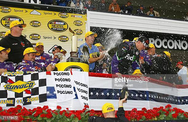 Owner JD Gibbs sprays Denny Hamlin driver of the FedEx Ground Chevrolet in Victory Lane after Hamlin's victory in the NASCAR Nextel Cup Series Pocono...