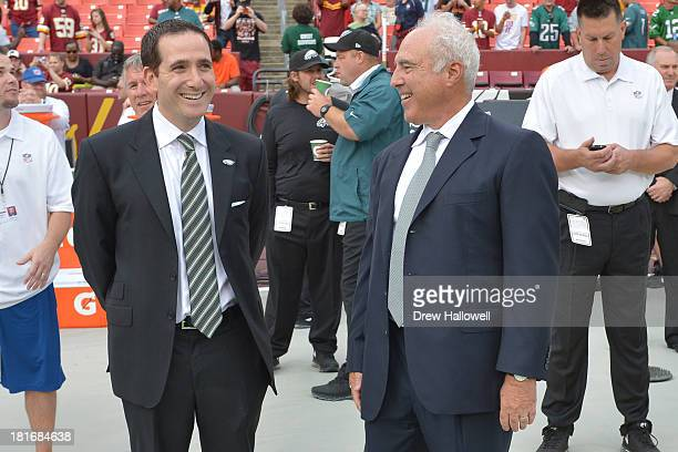 Owner Jeffrey Lurie of the Philadelphia Eagles and general manager Howie Roseman talk before the game at FedEx Field on September 9 2013 in Landover...