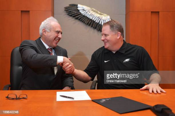 Owner Jeffrey Lurie of the Philadelphia Eagles and new head coach Chip Kelly after signing a contract at the NovaCare Complex on January 17, 2013 in...