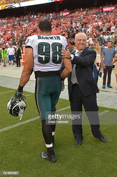 Owner Jeffrey Lurie of the Philadelphia Eagles greets Connor Barwin before the game at FedEx Field on September 9, 2013 in Landover, Maryland. The...