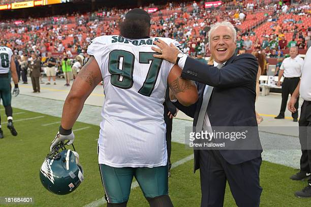 Owner Jeffrey Lurie of the Philadelphia Eagles greets Isaac Sopoaga before the game at FedEx Field on September 9, 2013 in Landover, Maryland. The...