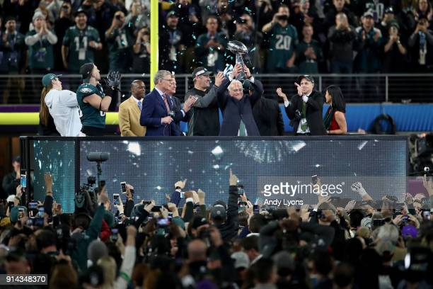 Owner Jeffrey Lurie of the Philadelphia Eagles raises the Vince Lombardi Trophy after defeating the New England Patriots 41-33 in Super Bowl LII at...