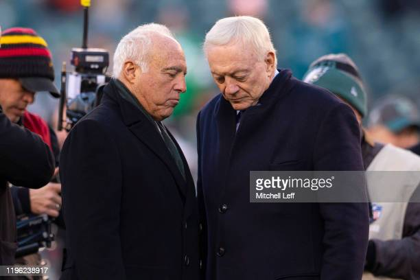 Owner Jeffrey Lurie of the Philadelphia Eagles talks to owner Jerry Jones of the Dallas Cowboys prior to the game at Lincoln Financial Field on...