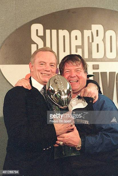 Owner Jerry Jones of the Dallas Cowboys and head coach Jimmy Johnson with the Vince Lombardi Trophy after the defeated the Buffalo Bills in Super...