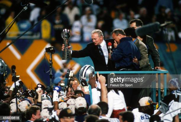 Owner Jerry Jones of the Dallas Cowboys holds up the Vince Lombardi Trophy after the Cowboy defeated the Pittsburgh Steelers in Super Bowl XXX on...