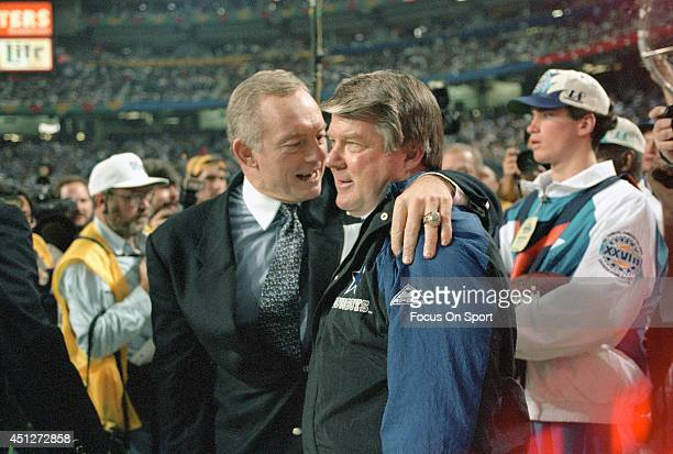 Owner Jerry Jones of the Dallas Cowboys hugs head coach Jimmy Johnson as the Cowboys leads the Buffalo Bills late in the fourth quarter of Super Bowl...