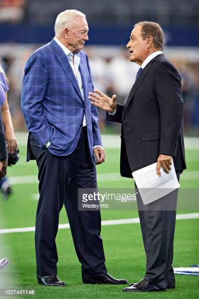 Owner Jerry Jones of the Dallas Cowboys talks with Al Michaels before a game against the Arizona Cardinals at ATT Stadium during week 3 of the...