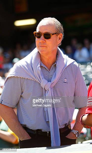 Owner Jim Crane of the Houston Astros enjoy the game between the Astros and the Oakland Athletics from the stands at Oco Coliseum on August 9 2015 in...