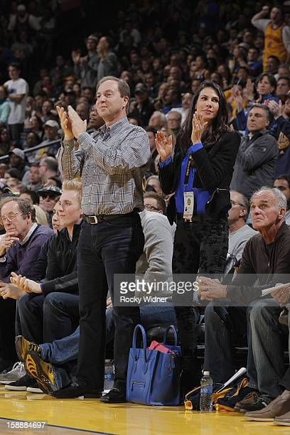 Owner Joe Lacob of the Golden State Warriors and Nicole Curran cheer on their team as they face off against the Los Angeles Lakers on December 22,...