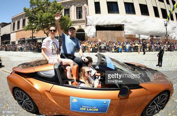 Owner Joe Lacob of the Golden State Warriors waves to the crowd during the Golden State Warriors Victory Parade on June 12 2018 in Oakland California...