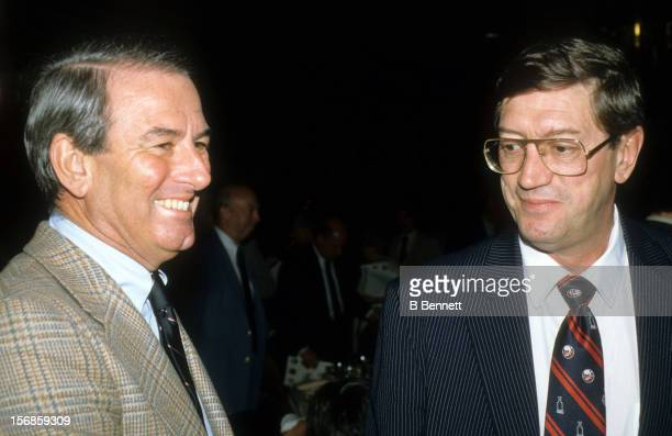 Owner John Pickett and head coach Al Arbour of the New York Islanders talk during a dinner in May 1983