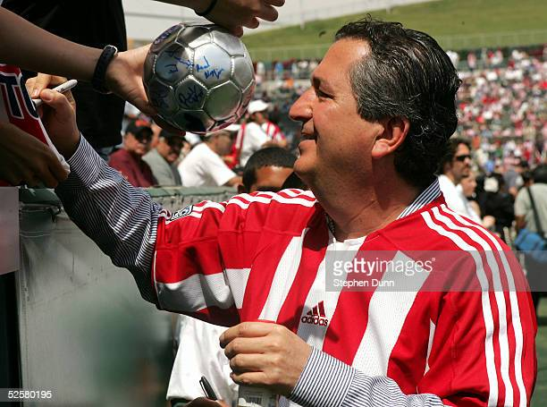 Owner Jorge Vergara of Chivas USA signs autographs before their inaugural Major League Soccer match with DC United on April 2 2005 at the Home Depot...