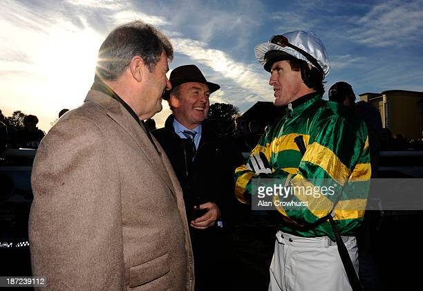 Owner JP McManus trainer Jonjo O'Neill and Tony McCoy at Towcester racecourse on November 07 2013 in Towcester England