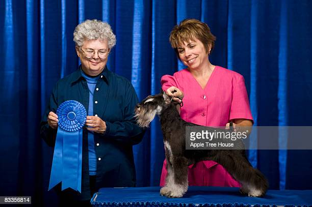 Owner, judge and dog with first place ribbon