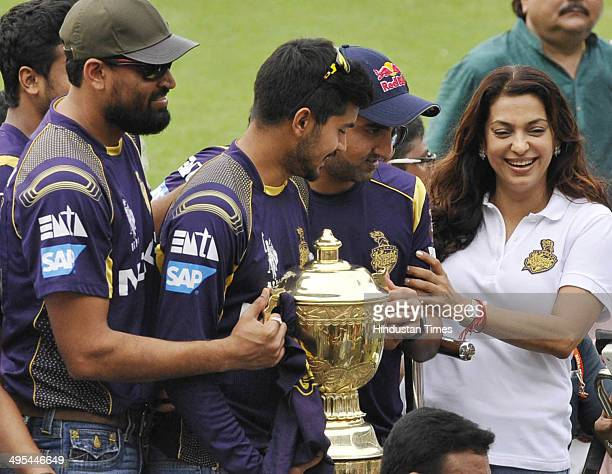 KKR owner Juhi Chawla with captain gautam Gambhir and other players hold the IPL champion trophy during felicitation ceremony of the IPL champions...