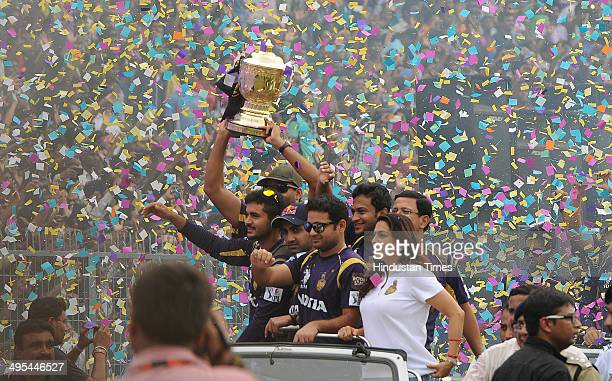 Owner Juhi Chawla with Piyush Chawla and other players carrying the champions trophy during felicitation ceremony of the IPL champions Kolkata Knight...