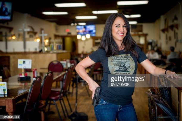 Owner Lauren Boebert poses for a portrait at Shooters Grill in Rifle, Colorado on April 24, 2018. - Lauren Boebert opened Shooters Grill in 2013 with...