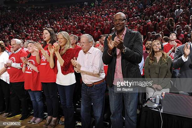 Owner Leslie Alexander of the Houston Rockets and Hall of Famer Clyde Drexler attend the game agasint the Golden State Warriors in Game Four of the...