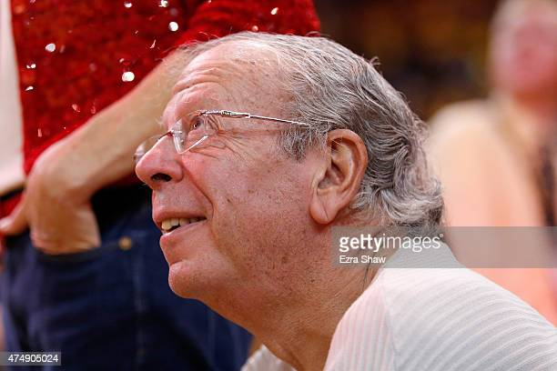 Owner Leslie Alexander of the Houston Rockets watches from courtside during game five of the Western Conference Finals of the 2015 NBA Playoffs at...