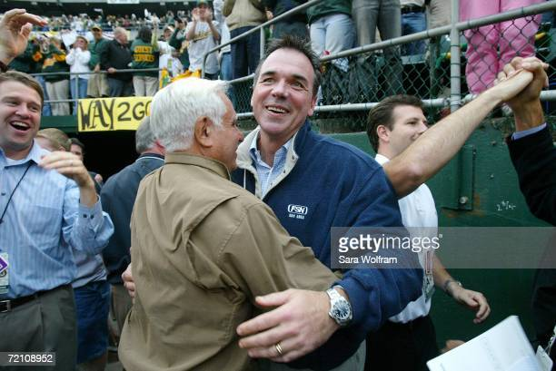 Owner Lewis Wolff and General Manager Billy Beane of the Oakland Athletics celebrate after the final out of game three of the American League...