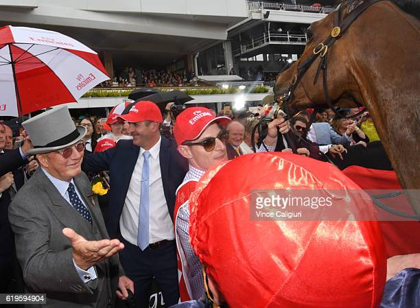 Owner Lloyd Williams congratulates Kerrin McEvoy after Almandin won Race 7 the Emirates Melbourne Cup on Melbourne Cup Day at Flemington Racecourse...