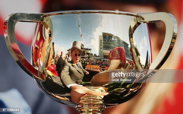 Owner Lloyd Williams is reflected in the Melbourne Cup trophy after Rekindling ridden by jockey Corey Brown won race 7 the 2017 Melbourne Cup during...