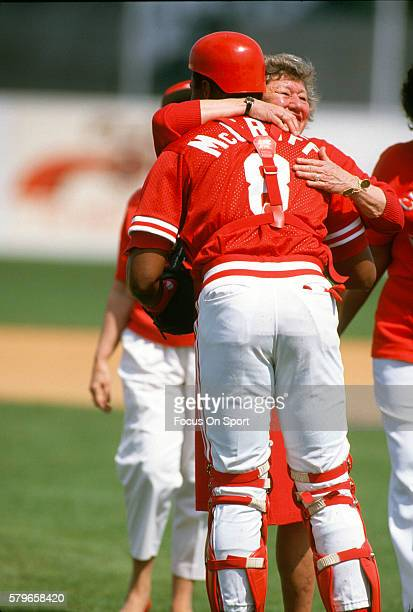 Owner Marge Schott of the Cincinnati Reds hugs catcher Terry McGriff prior to the start of a Major League Baseball spring training game circa 1990 in...