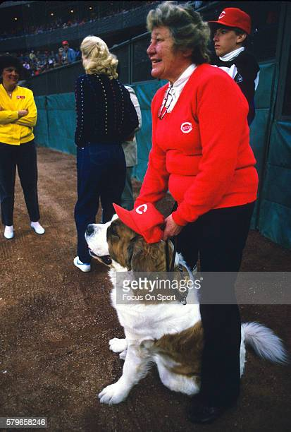 Owner Marge Schott of the Cincinnati Reds stands with her Saint Bernard dog Schottzie prior to the start of a Major League Baseball game circa 1993...
