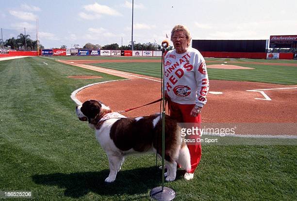 Owner Marge Schott of the Cincinnati Reds with her Saint Bernard dog Schottzie talking to the fans prior to the start of a Major League Baseball...