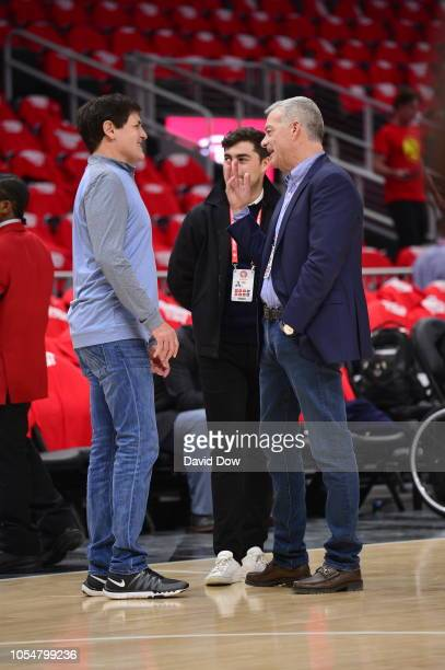 Owner Mark Cuban of the Dallas Mavericks and Owner Antony Ressler of the Atlanta Hawks talk prior to a game on October 24 2018 at State Farm Arena in...