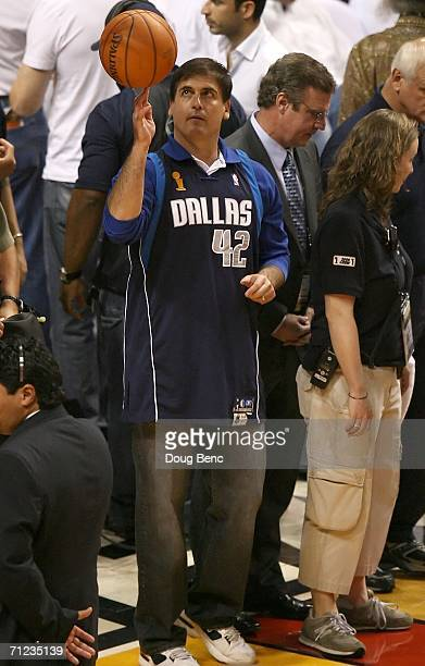 Owner Mark Cuban of the Dallas Mavericks spins a ball on his finger before the start of the game against the Miami Heat in game five of the 2006 NBA...